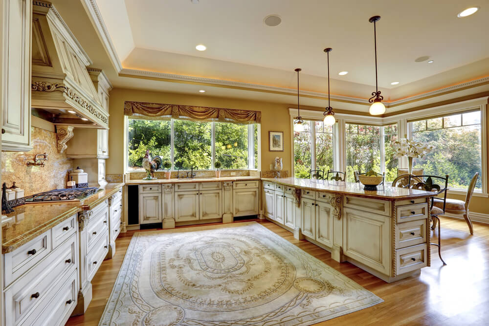 Large white kitchen with windows