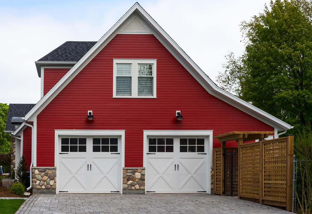 This Red, Side Facing Garage Features Two Car Carriage Style Doors In White  Wood