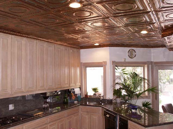 white kitchen with copper ceiling