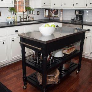 white kitchen with dark portable kitchen island on wheels
