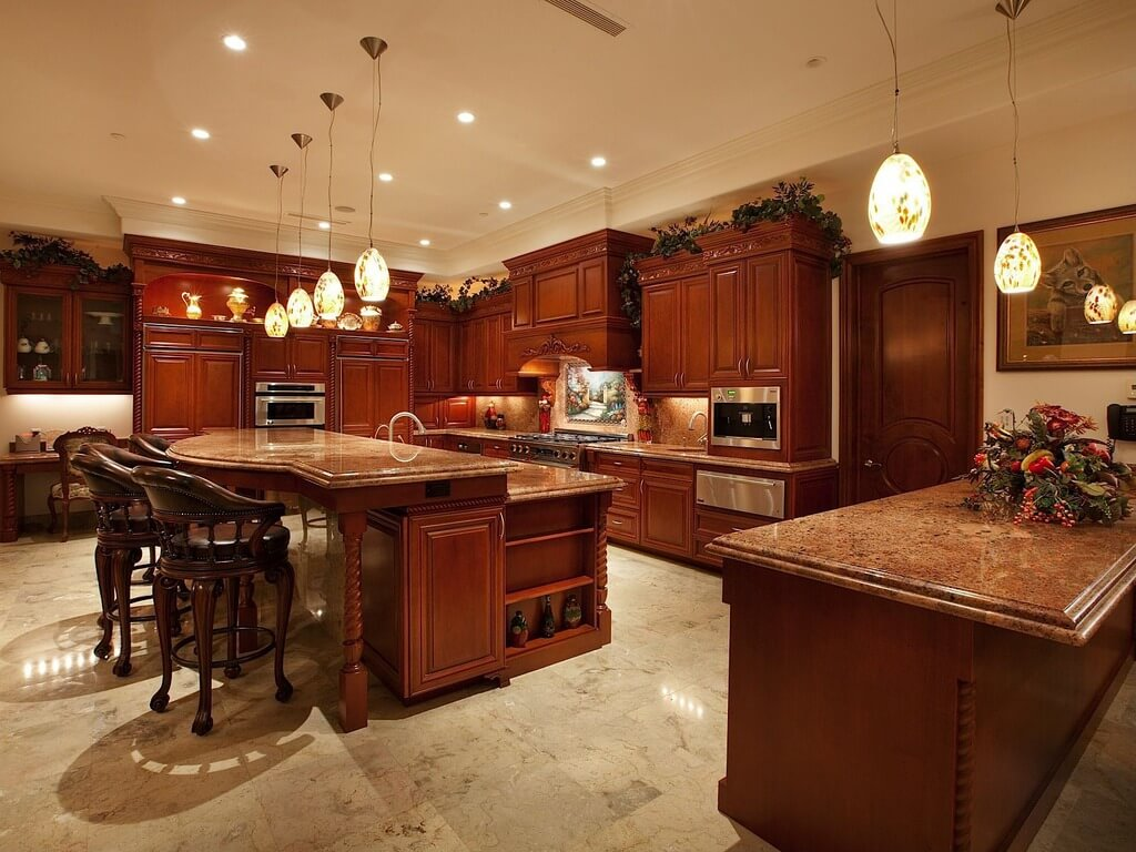 Rich Red Wood Over Beige Marble Flooring Throughout This Kitchen. Large  Two Tiered Island