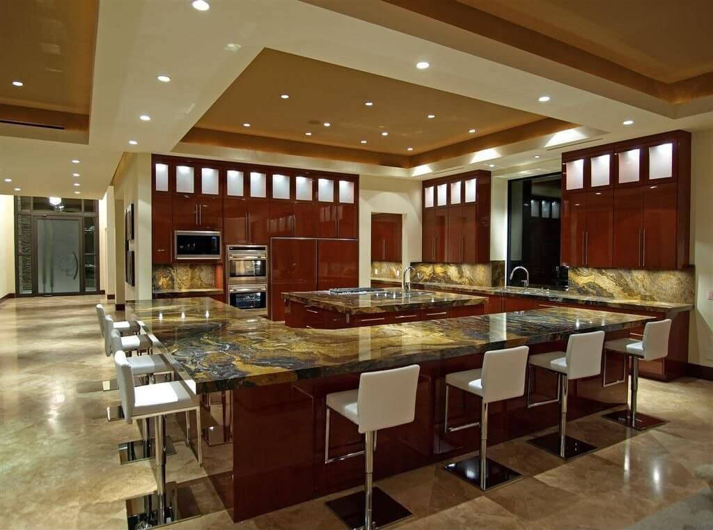 The Kitchen Is Situated In A Large Open Concept Living Area. The Entire  Outer Counter
