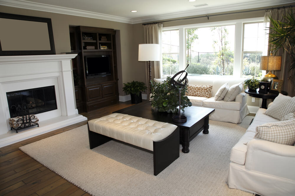black wood coffee table center this white and tan living room with