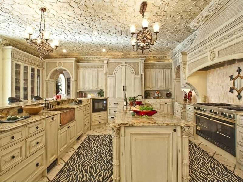 White kitchen with the distressed look made even more interesting with a large zebra-patterned floor.