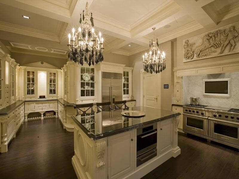 Suspend Chandeliers From Coffered Ceiling Spacious White Kitchen With Dark Flooring And Countertops Custom Cabinetry Throughout Providing A Great Deal
