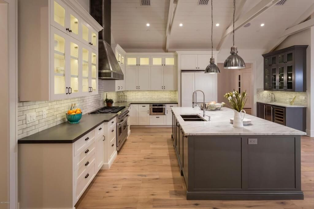 Large Modern Kitchen Design With White And Grey Color Scheme. The Huge  Center Space Includes