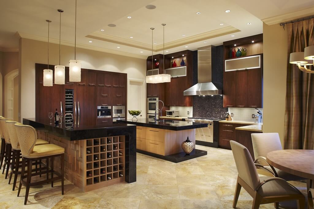 Modern kitchen design with warmth from the natural wood tone used throughout. The clean lines and smooth surfaces give it a modern look while the natural wood provide the space warmth.