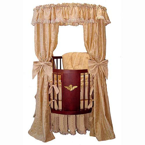 Florentine style in cherry wood is accented with a gilded cherub on front panel, on this crib from Little Angel. Circular design ensures zero risk of sharp angles and full visibility for baby and parents. Canopy fabric adds elegant, classic touch.