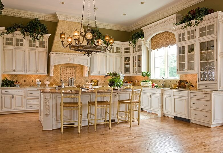 Spacious White Kitchen With Large Central Island