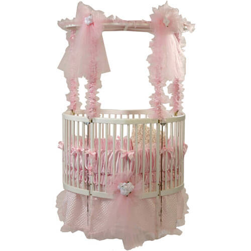 While not perfectly circular, this heart shaped crib from Baby Dear features smooth, rounded edges for safety and comfort. Elegant pink canopy is removable for cleaner, simple look. Base features multi-position lock for varying placement.