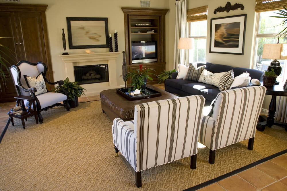 Traditional Living Room Set Up With Striped Twin Armchairs Ornate Accent Chair And