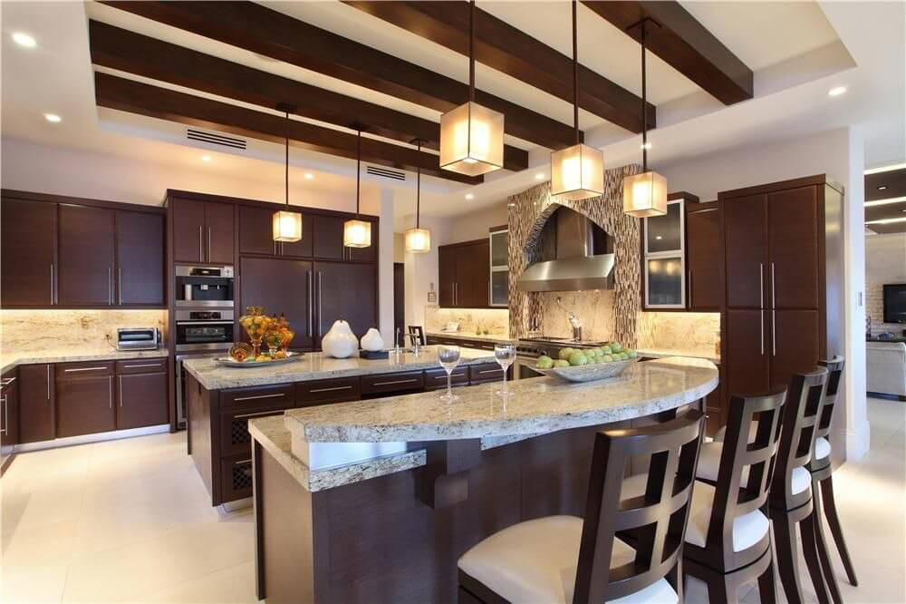 Contemporary Cabinetry With Stainless Fixtures Against Dark Wood Make Up  The Design Of This Luxury Kitchen Images