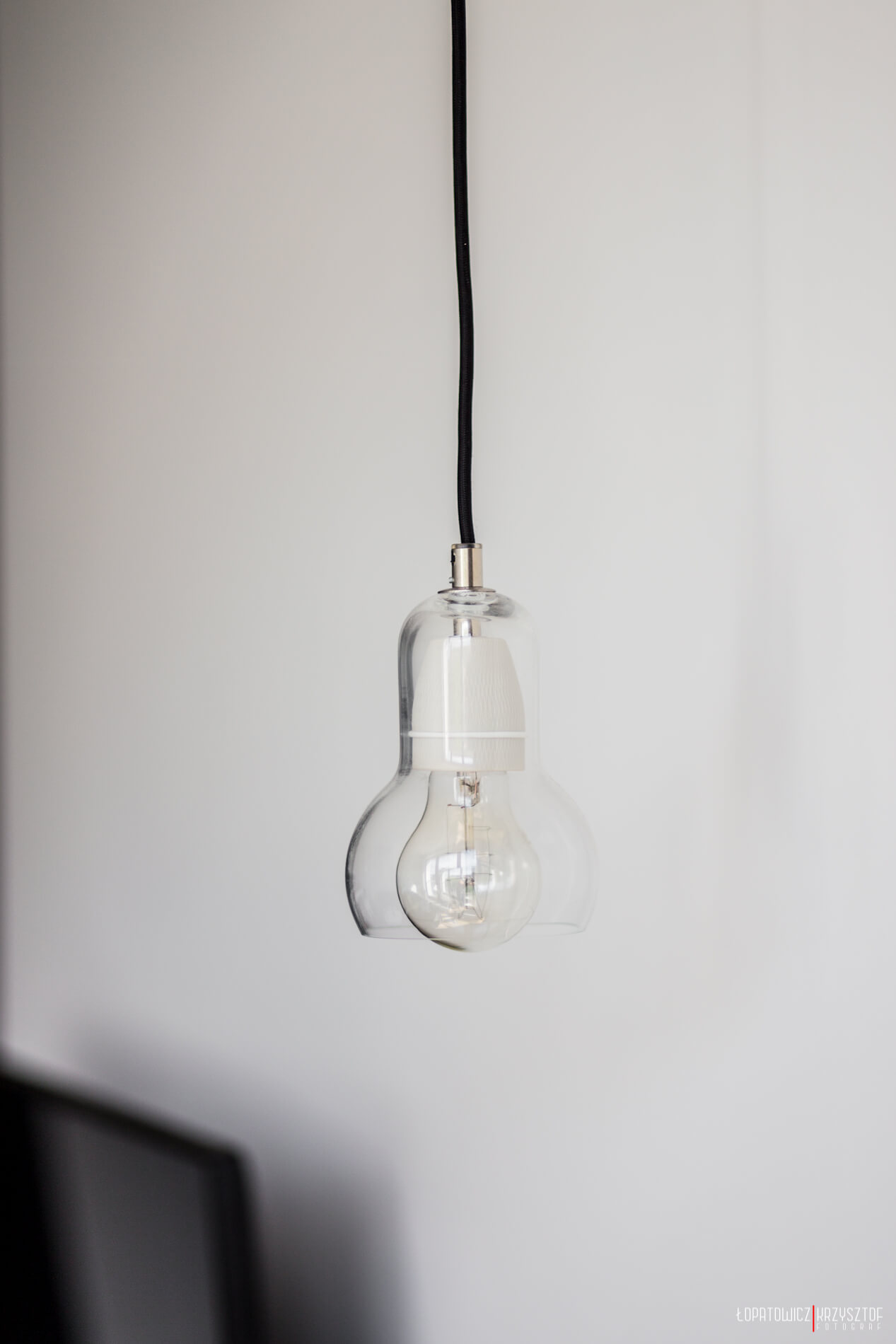 One of the singular light fixtures, this one features minimal glass wrap around a single bulb.
