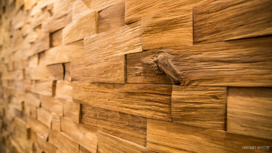 Close up detail of the wood brick style wall surface. Natural split wood cut into rectangles interlocks for complex visual appeal.