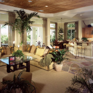 Spacious living room and kitchen open concept living space with fashionable sectional sofa.