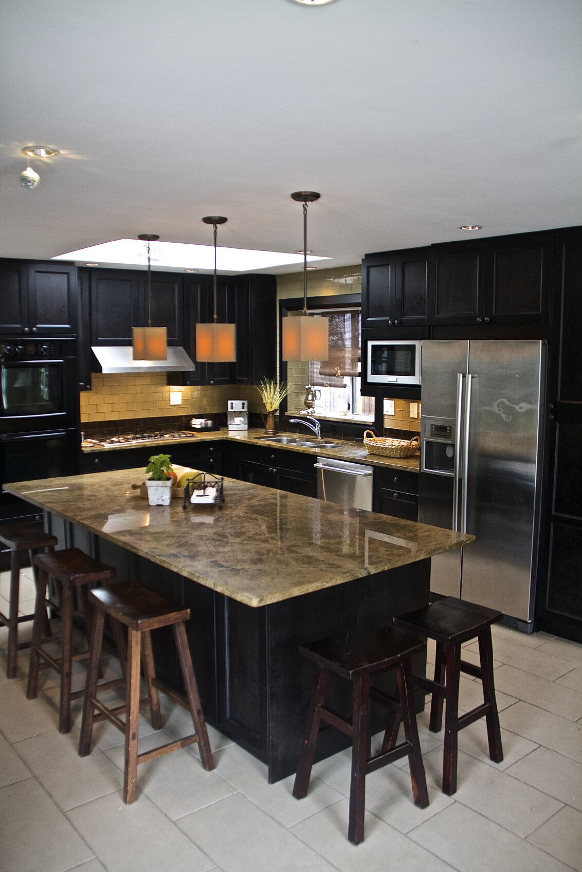 Contemporary Black L Shaped Kitchen With Long Island Set On White Tile Floor .