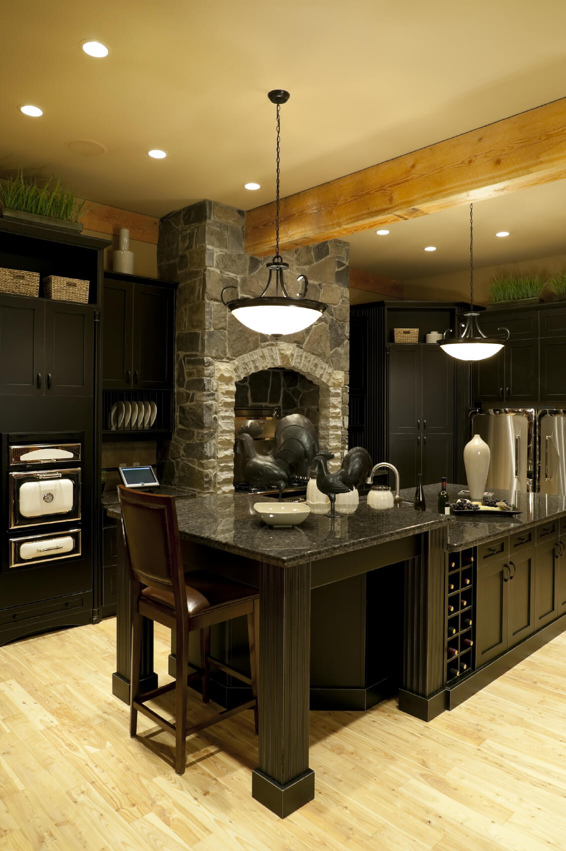Luxury Black Kitchen With 2 Tier Island And Light Wood Ceiling Beams