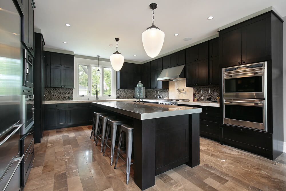 Contemporary craftsman style kitchen with black wood cabinets on a light wood floor. The black is offset with stainless steel throughout ... & 52 Dark Kitchens with Dark Wood OR Black Kitchen Cabinets (2019)