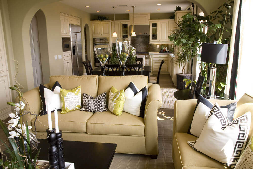 This Living Room Features Light Gold Hued Sofas, Dark Wood Coffee Table,  And Dark