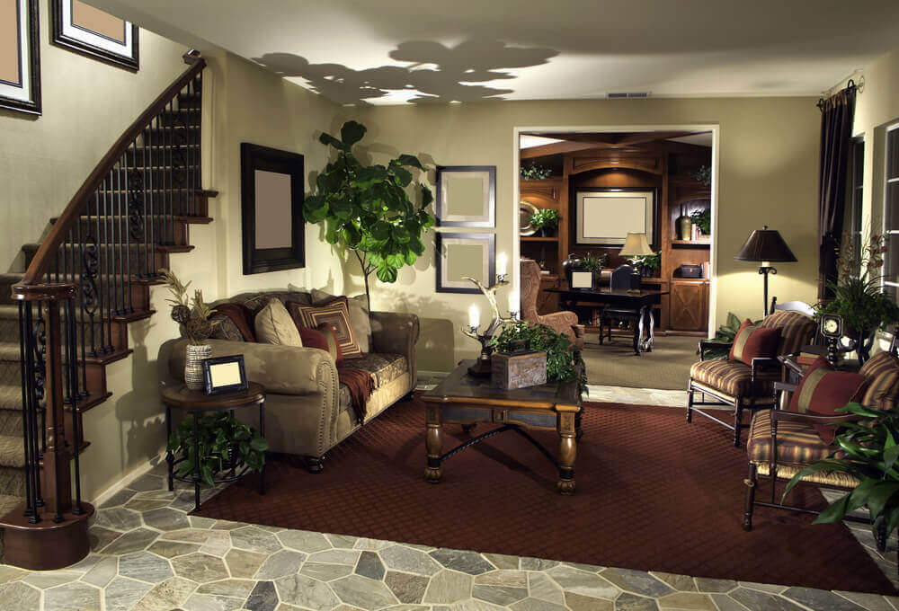 Attractive This Cozy Living Room Setup Stands Beneath The Carved Wood And Wrought Iron  Stair Railing At
