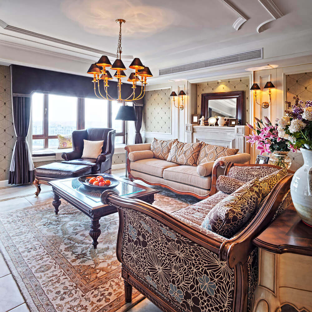 Lavish Appointments In This Room Include Curved Wood Framed Sofas Arrow Foot Coffee Table With