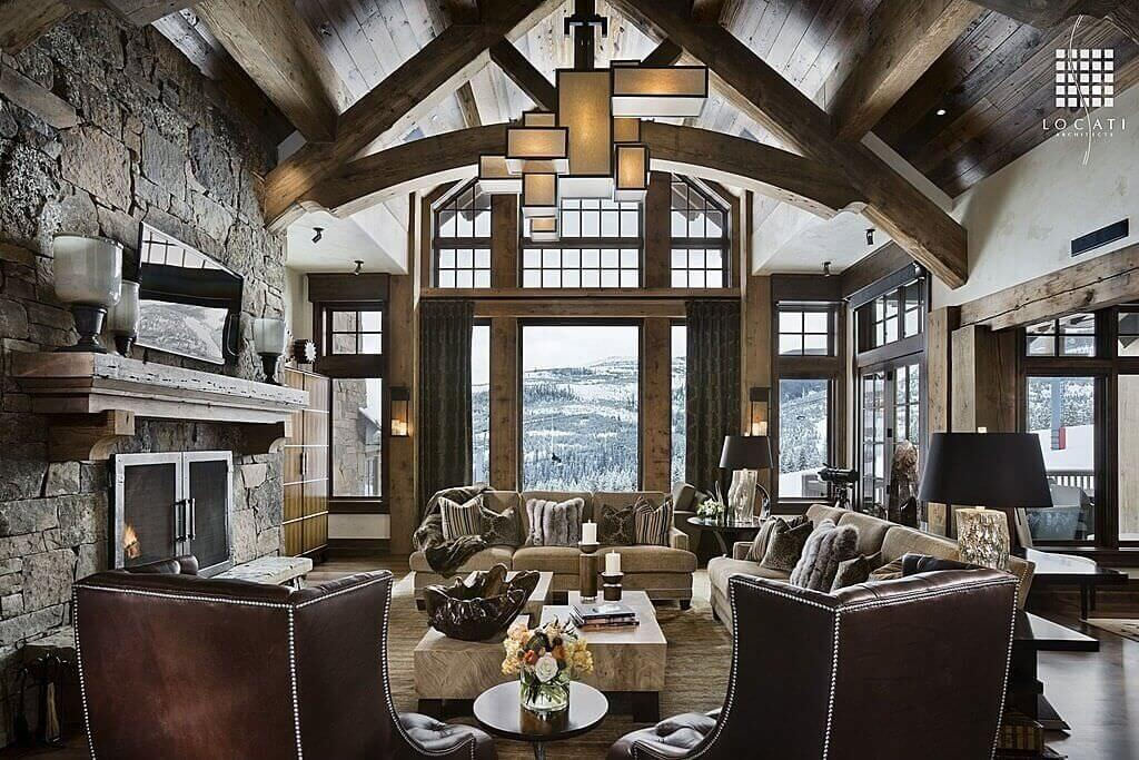 Soaring, Vaulted Ceiling With Exposed Natural Wood Beams Frame This  Luxurious, Rustic Living Room