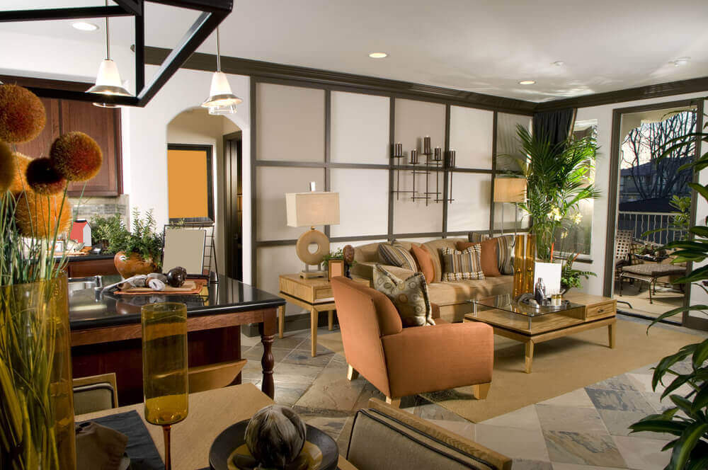 Cozy Living Room Features Contemporary Styling With Twin Level Glass And Natural Wood Coffee Table