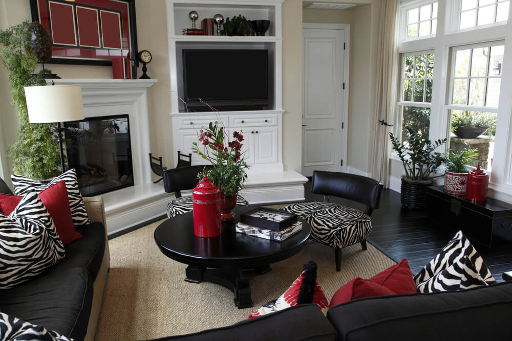 Bon Casual Family Room Made Elegant With Zebra Print Pillows And Red Pillows.