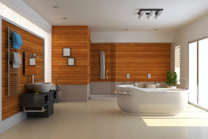Here's another example of warm natural wood contrasting with bright tile tones. Wall details in wood are paired with black sculpted vanity with vessel sink and singular soaking tub in this minimalist setup.