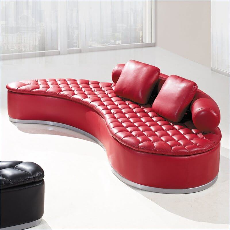 Here's a kidney-shaped red sectional sofa with tufted seat. It's a sectional bench style sofa with a partial back.