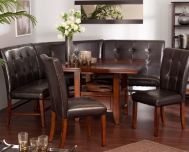 Dark cushioned breakfast nook with table and chairs
