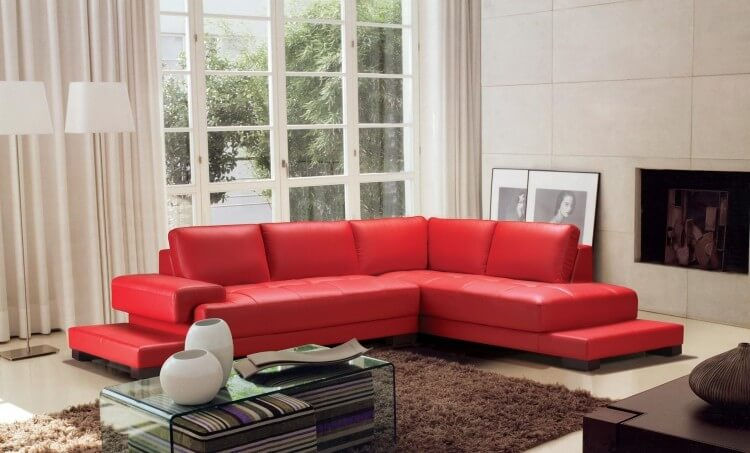 Here's another platform based red sectional. It's a solid design where the seating sits atop a solid base.
