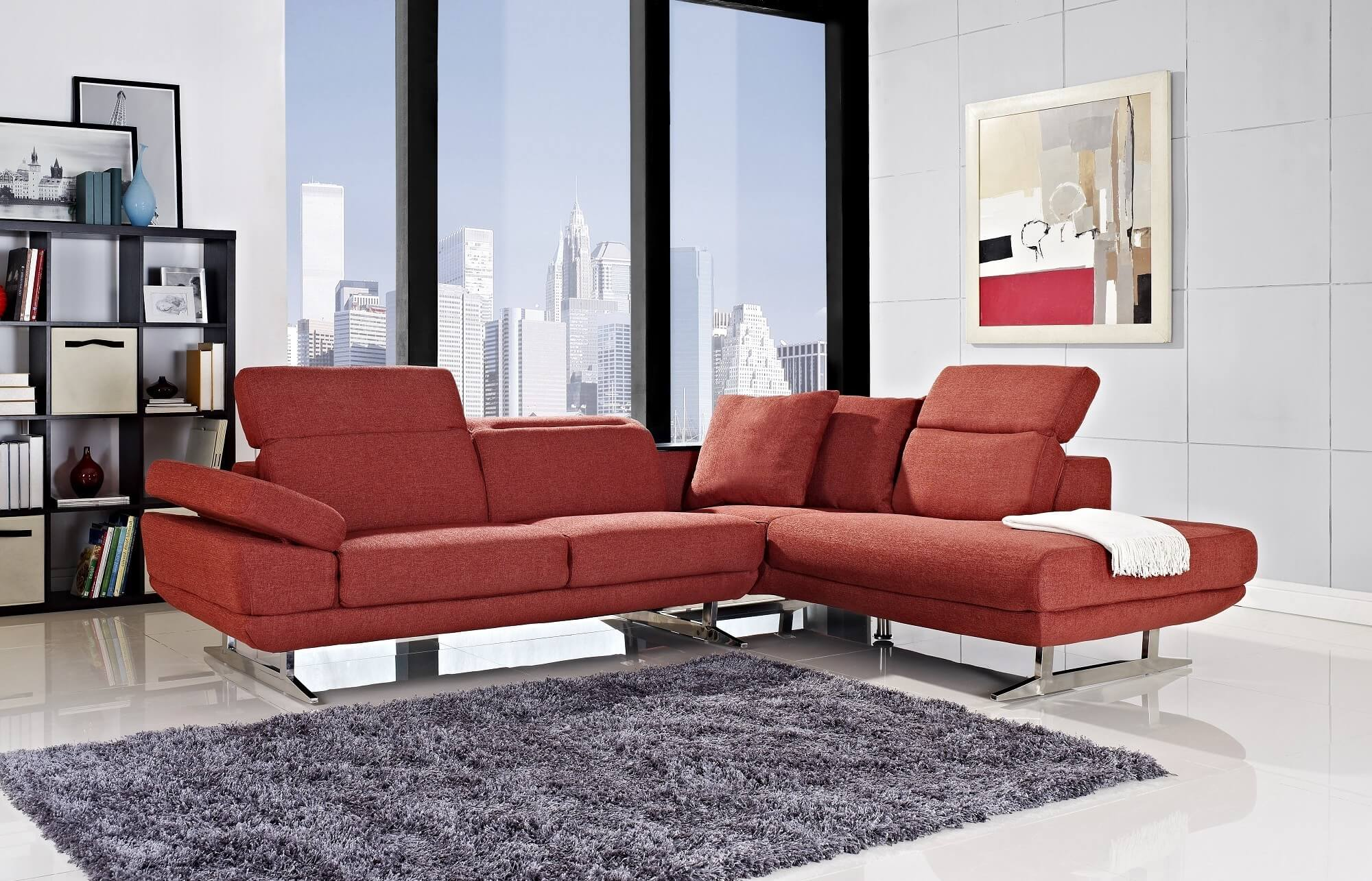 This modern red sectional includes adjustable headrests, an adjustable armrest and is made with a solid wood frame, chrome legs and fabric upholstery.