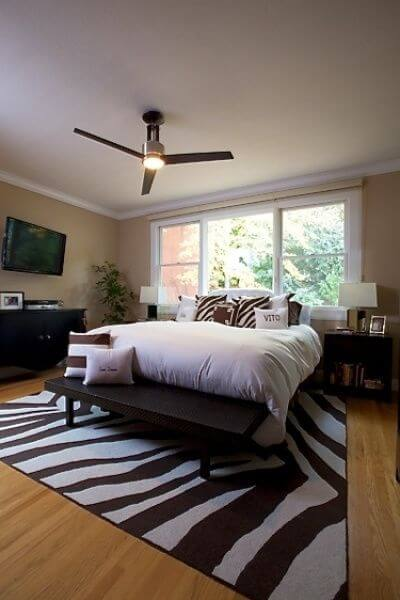 Here's a great example of placing a zebra print rug under the bed.