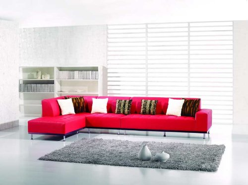 This soft leather red sectional stands on stylish chrome legs. The back extends for most of the the length of the sofa.