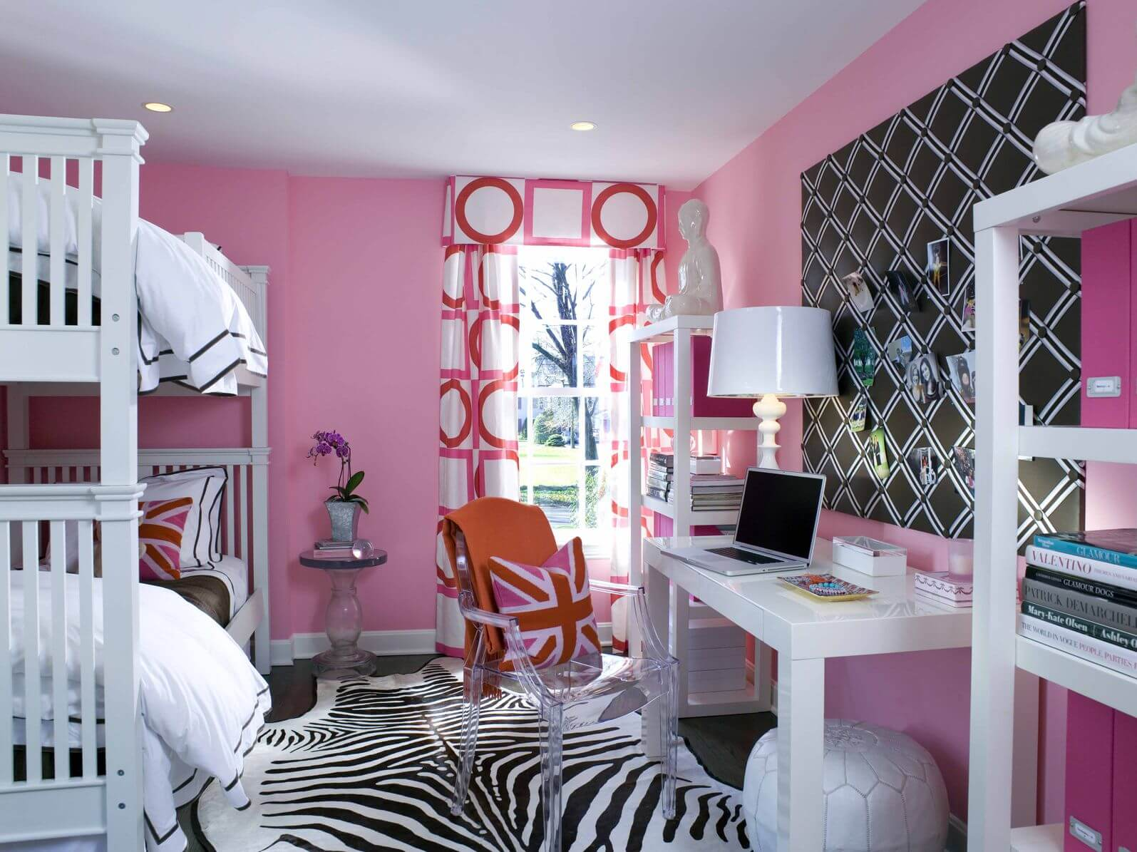 Here's an example of a kid's room incorporating zebra print with a rug. It's playful and lessens the brightness of the pink color motif throughout.