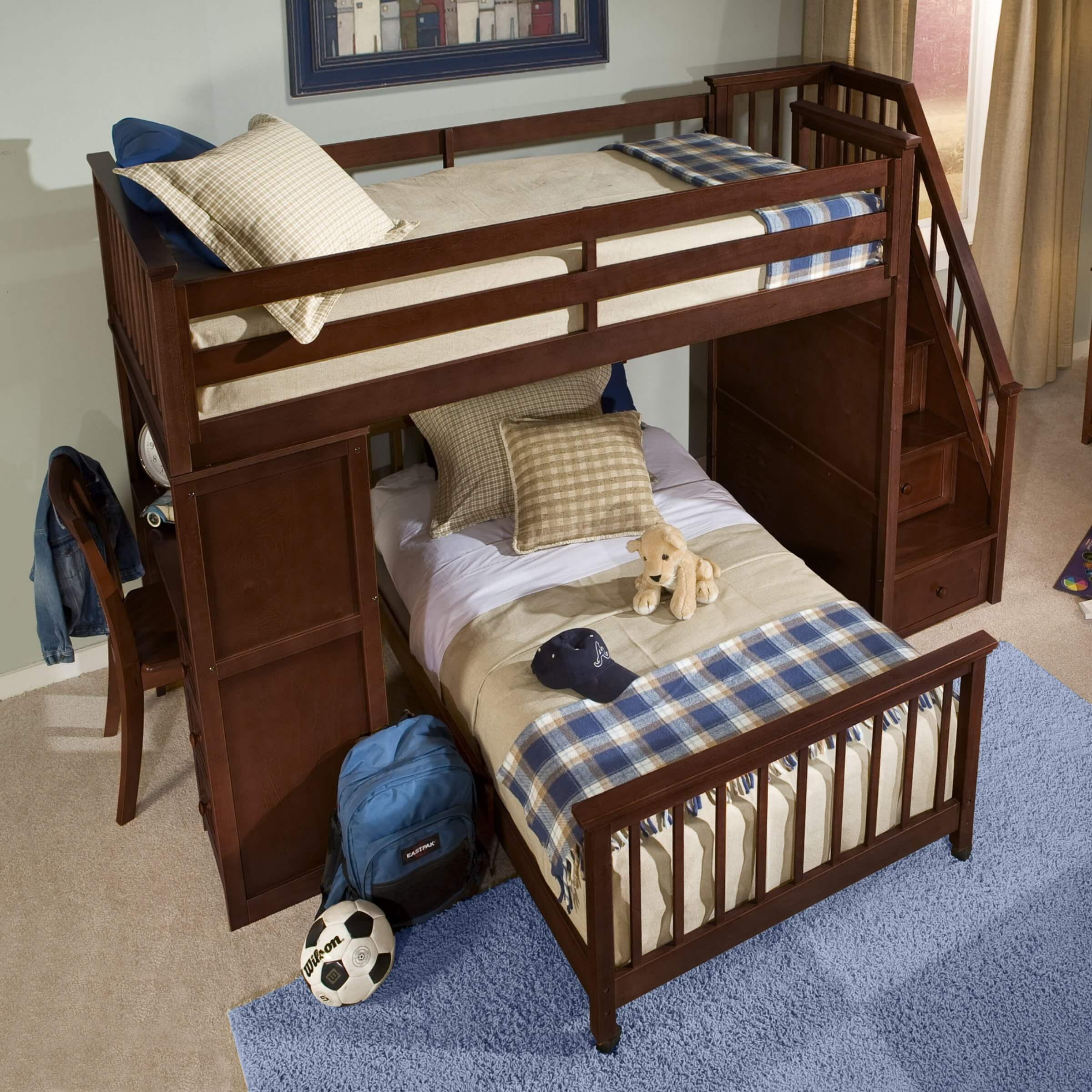 Cherry finished hardwood L-shaped bunk that gives you the option for a full or twin lower bed. Access to the upper bunk is via narrow staircase with railing. The other side of the unit includes a desk.