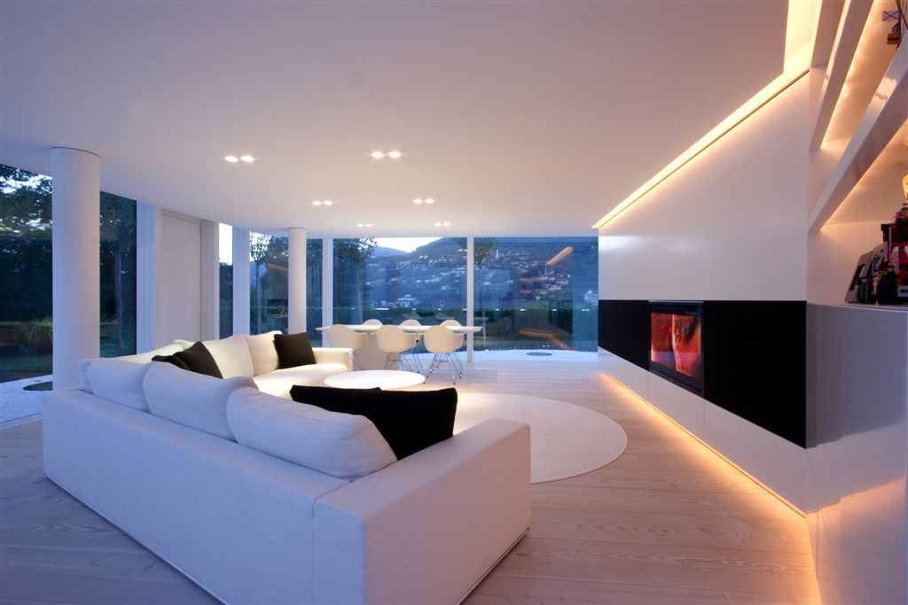 Living RoomAnother Sublime Example Of White Minimalist Decor Surrounding Natural Hardwood Flooring This Room Features