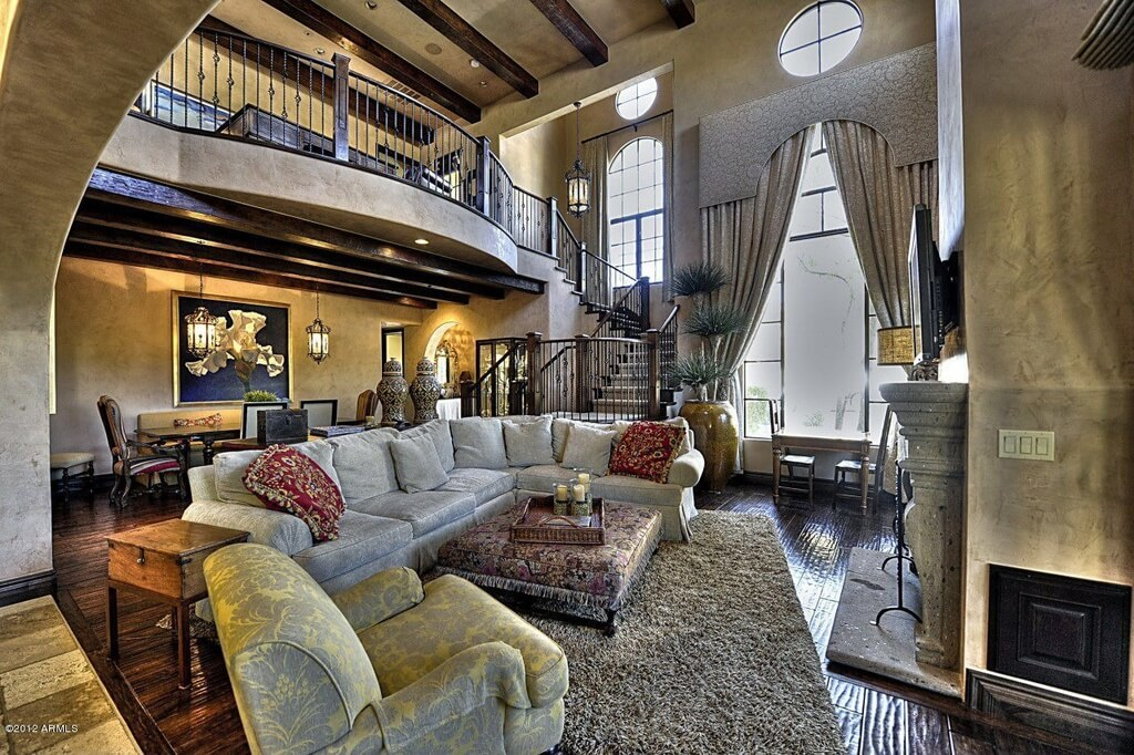 Lavish detail abounds in this stately living room  from enormous drapes  over the two story. 54 Living Rooms with Soaring 2 Story   Cathedral Ceilings
