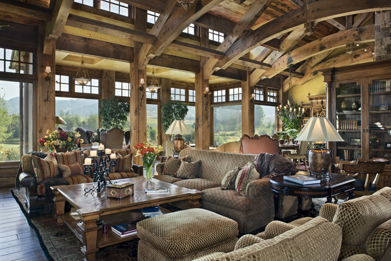 Rustic Styled Living Room Spreads A Lavish Variety Of Sofas And Rich Wood  Furniture Below A