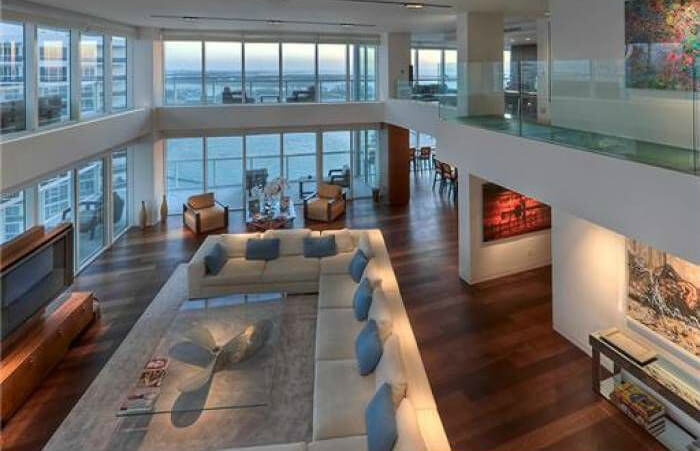 this above view from the second floor shows the massive sectional sofa and glass topped