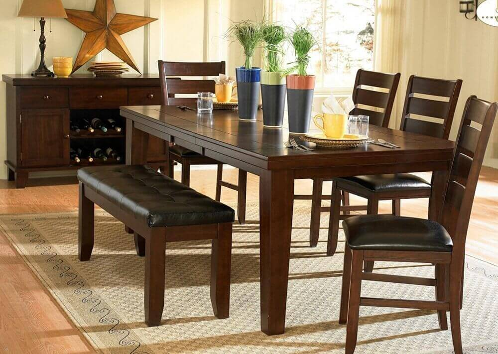 A stunning dark oak finish, birch veneer dining set with cushioned chairs and bench. The rectangle table includes an extension (which can be very handy).