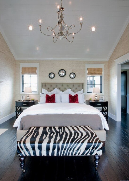 Here The Ottoman At The Foot Of The Bed Is The Zebra Print Décor Item.