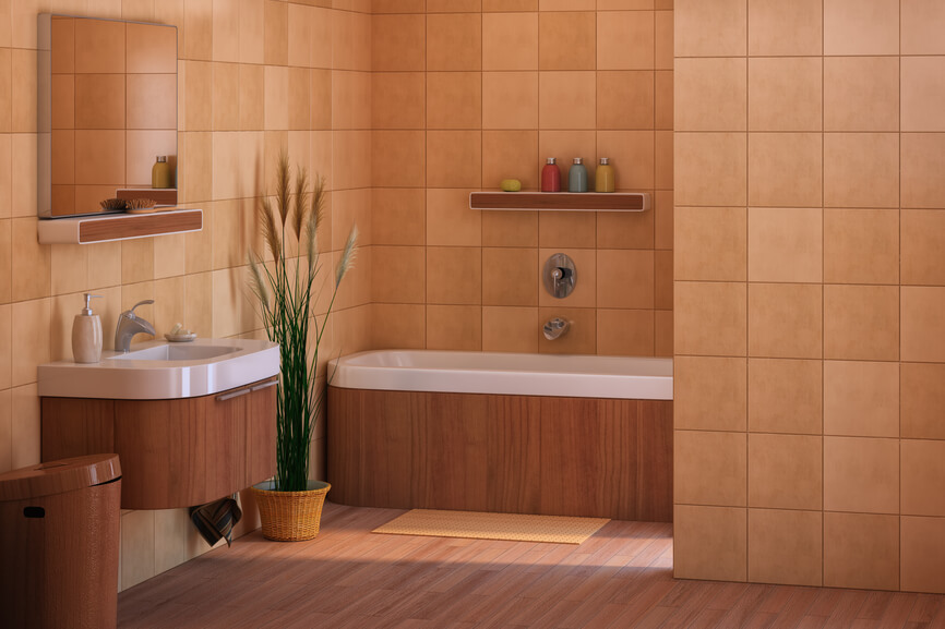 Modern, minimal bathroom with beige tile walls features rounded vanity and bathtub design with warm natural wood tone matching the hardwood flooring and small shelves.