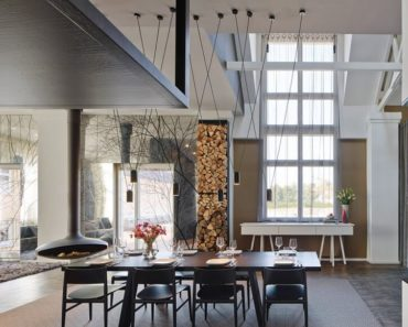 View of open concept living space in loft by Ippolito Fleitz Group
