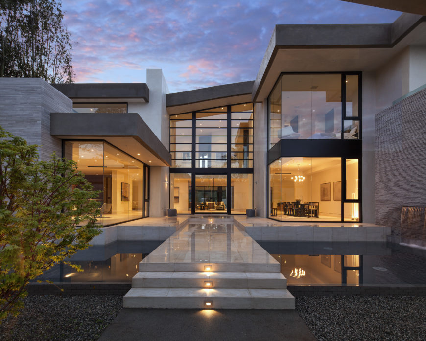 Curb view of the magnificent steel and glass modern mansion in Los Angeles by McClean Designs.