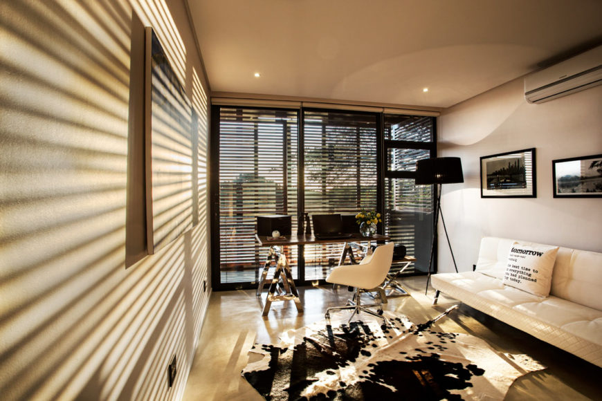 Here's the study during sunset: dappled slits of light through the timber panels grant moody lighting.