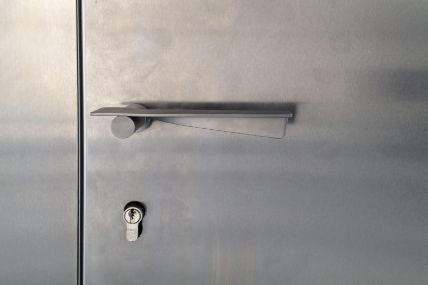 Stainless steel door handle is one of many accents throughout the home reflecting the strong construction methods.