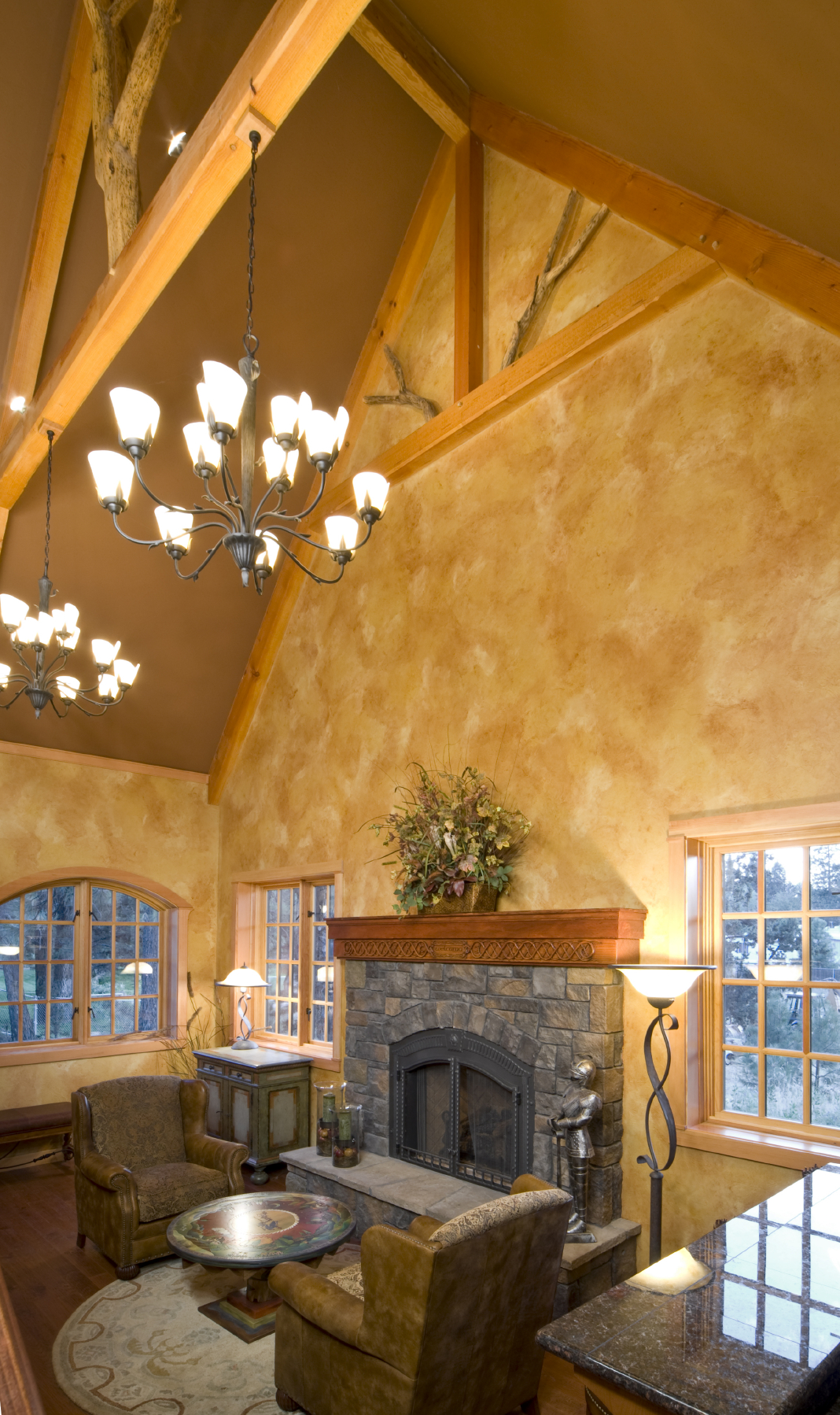 soaring vaulted ceiling with exposed natural wood beams hovers over this cozy space with large - Innovative Wood Beam Ceiling