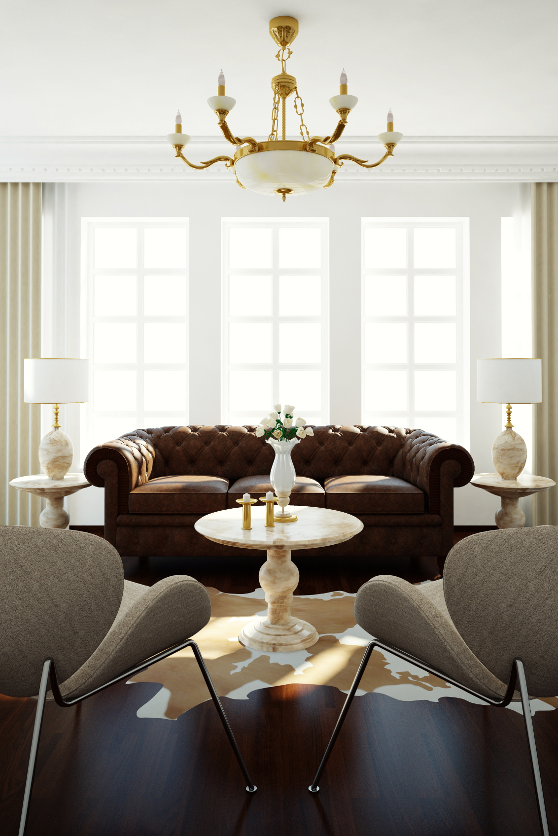 Simple chairs are paired with a quilted rich brown sofa matching marble side tables